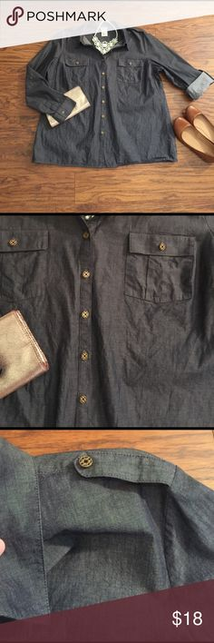 Lightweight chambray shirt by Jaclyn Smith Size 1X. Beautiful medium/dark wash chambray shirt. Button down front, double breast pockets. Wear sleeves long or rolled and coffee. Military style buttons at shoulders. 200% cotton. Super cute and comfy for Spring! Jaclyn Smith Tops Button Down Shirts