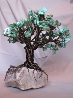 This wire tree uses smoked quartz colored copper wire with Malachite mother of pearl for the leaves. I love using mother of pearl chip stones for the