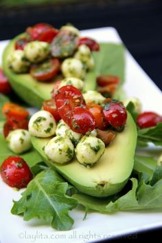 Avocados filled with tomato mozzarella salad.