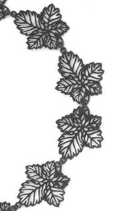 An early 19th century Berlin ironwork necklace. Of diaperwork design, the graduated openwork leaves finely pierced, to a circular openwork clasp.