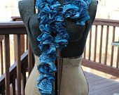 Beautful, flowing, crochet scarf in shades of blue.