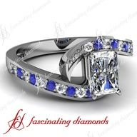 Emerald cut diamond ring with blue sapphire side stones   #rings . www.finditforweddings and  www.facebook.com/FIND.IT.For.Weddings