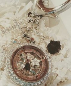 Gorgeous locket look filled with meaningful charms. So much sparkle! www.makandcharms.origamiowl.com