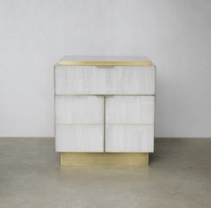 "gypse, ""snow white"" veneer and patinated brass cabinet. Designed by Douglas Mackie"