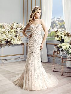 Val Stefani Style ELSIE Swarovski crystals are intricately placed on this mermaid gown to accentuate your curves in all the right places.