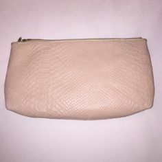 🎀 Elliott Lucca Pink Snake Skin Clutch 🎀 Elliott Lucca pink snake skin clutch. In perfect condition only used once for prom. Comes with strap to wear cross body or on shoulder. It's also very large and holds a lot! 12 inches by 6.5 inches. Elliott Lucca Bags Clutches & Wristlets