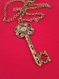 UPCYCLED Steampunk Bronze Key Necklace / Vintage inspired key pendant / Unique Gift for her / Recycled watch parts / Nerd Gift / Geek Gift / Alternative Goth Gift / Steampunk gift / Christmas Gift / Upcycled / Eco-friendly / Handmade    This unique necklace is made from genuine upcycled watch parts.   | Shop all of our products at http://spreesy.com/socialfashionboutique   | Pinterest selling powered by Spreesy.com