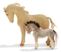 TWO STEIFF FELT STANDING HORSES, one dappled grey, (1117?), brown and black glass eyes, neck arched, horsehair mane and tail, red felt bridle, 1930s --7in. (18cm.) long; and one light brown, (1128?), brown and black glass eyes, neck arched, hair mane and tail, brown hooves and FF button, 1930s --10¼in. (27cm.) long (two small patched holes, some wear and fading, with later added cloth saddle and bridle)