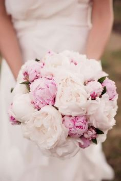 If peonies are in season, we could do this type of a bouquet or sub deep red peonies for the pinks ones here. -- This look is also achievable with GARDEN ROSES.