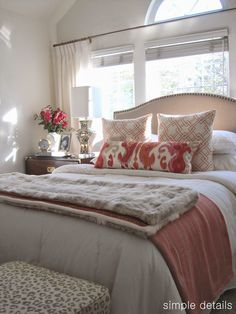 Bed placement in front of the window, beautiful neutrals with pop of color