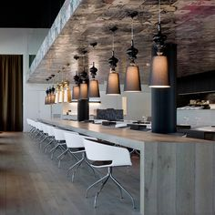 ronda for andreu world - white chairs, matching wood for the bench table and floors and tiles on the ceiling that those fantastic lights are hanging from...