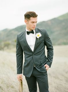 Handsome tuxedo with a simple white flower bout.  Photo by KT Merry Photography. www.wedsociety.com  #wedding #grooms