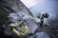 Volcano Spews Blue Fire While Sulfur Miners Work Feet Away