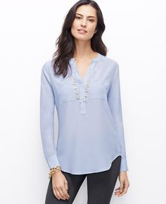 Designed in luxuriously lightweight silk, this wear-now tunic is a perfect match for the season's slim pants and skinny jeans. Split neck with mandarin collar. Long sleeves with button closure. Chest pockets. Hidden button front placket. Back yoke with box pleat. Shirttail hem.