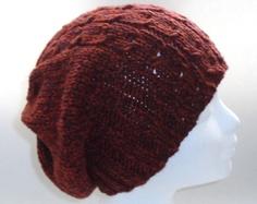 Geschenkidee - Lässige Mütze in rostrot mit Zopfmuster - Superweich und besonders warm durch Kaschmir und Merino: Diese Mütze wird Ihr ständiger Begleiter im kommenden Winter!