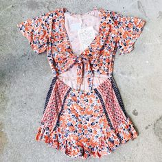 Free People tie front romper This romper is soooooo adaptable. It is perfect for the beach, festivals, picnics...the possibilities are endless! I am only selling because I bought a few other rompers I will get more use out of. Free People Other