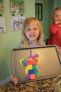 haha that kid looks happy! but seriously, i might need to make this for neveah! Let Kids Create: Road Trip  (just put a magnet on the back of foam shapes)