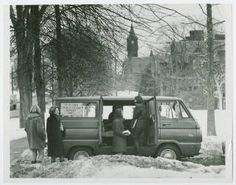 """Students at """"4 College Transportation Service"""" van on a winter day, with Mary Lyon Hall in the background :: Archives & Special Collections Digital Images :: circa 1968"""