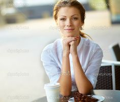 Portrait of young smiling business woman resting her chin on han | Stock Photo © Andrei Zarubaika #12478769