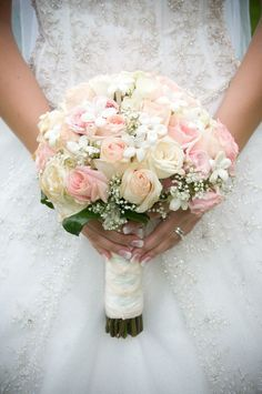 Cute white and pink bridal bouquet of pink roses and white roses