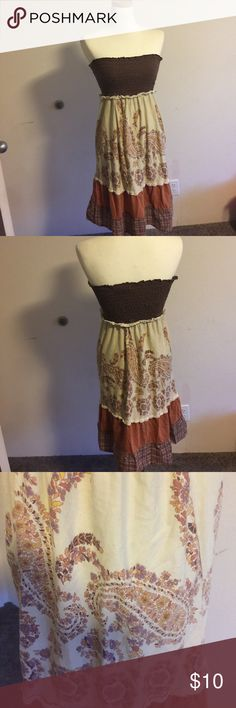 Strapless dress Strapless dress. Hippie style.  Mainly Brown Orange Color.  Used. Good condition. Dresses