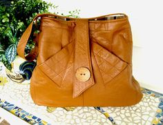 ♥ I created this Large Caramel Brown Handbag from a Lovingly Worn Recycled 1970s Ladies Trench Coat. The beautifully soft Leather has lots of Character and Charm, making this Handbag Definitely One of a Kind!!!! This is my favorite color Leather to work with.  ♥ Each bag I make is different......My inspiration comes from the materials I am working with. All of my Handbags are designed and completely made by me. I do not have any employees, nor do I outsource any of my work. The best thing is…