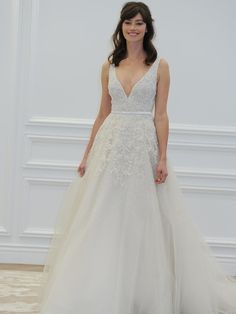 Anne Barge plunging neckline with belt wedding dress from Spring 2016