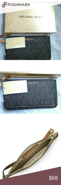 """New MICHAEL KORS Signature Medium Zipper Wristlet Framed with metallic trim, MICHAELMichael?Kors' signature logo-stamped, zip-top wristlet is sleek and shining.   Coated twill wristlet with signature logo prints  Wristlet strap  Top zip closure  18k?goldplated?hardware  Three inside credit card slots  Lined  8"""" W X 4"""" H X 1""""D  PVC/polyester/cotton/polyurethane Michael Kors Bags Clutches & Wristlets"""