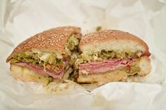 Muffaletta Sandwich - Hot from the oven, dripping with melted provolone and Swiss cheese and a healthy layer of ham, Genoa salami and pastrami. A house-made olive salad provides the perfect counterpoint to the meats and cheeses {Napoleon House, New Orleans, LA, USA}