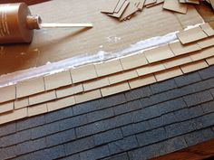 I made the roof of the dollhouse out of cardboard pieces, then I sprayed the whole thing with a textured paint.