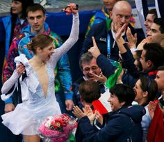 With Team Skating, It's Now Kiss, Cry, Squeeze In.  Suddenly, figure skating's moment of high anxiety looks like a competition for most awkward family photo.  Carolina Kostner of Italy joining the crowd in her country's kiss-and-cry area.