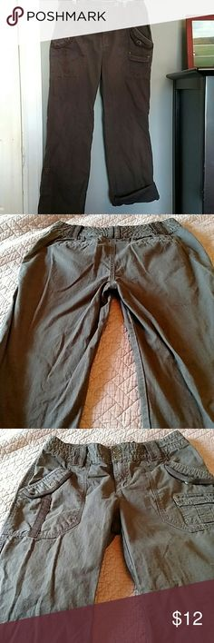 Dkny active brown pants size 4 DKNY active brown size 4 pants. You can wear them as pants or as Capri pants. The bottom rolls up and snaps to keep in place. The length of the pants is about 38.5 inches. Gently worn Dkny Pants