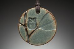 Owl in Tree ceramic pendant (round)