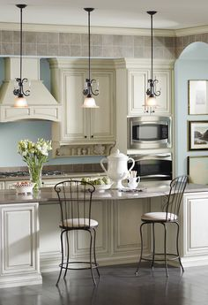 Chic lighting and bar stools in this gorgeous kitchen; Charleston Forge.-I have these same drop down lights.  Mine need the curly pieces on top.