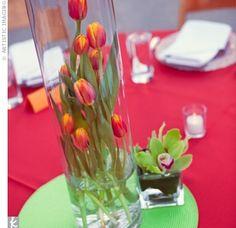 Orange tulips in an over sized vase. Love it.