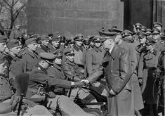 Adolf Hitler greets Wehrmacht soldiers wounded in battle in Heldengedenktag memorial in Berlin, Sunday March 21, 1943.