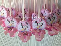 """This beautiful Minnie Mouse pacifier necklace are a fancy way to present favors for your Baby Shower. Use these cute baby shower pacifiers as baby shower favors and a """"Don't Say Baby"""" game. The necklace is made of 1/8 satin ribbon. Each pacifier measures 2.75"""" long. Have two-sided minnie mouse and bows."""