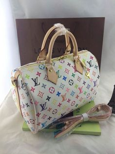 Louis Vuitton White Multi-Color Star Rectangle Pattern – CHICS – Beautiful Handbags & Accessories