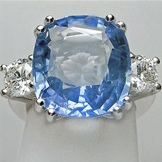 Composition: Solid White Gold 18K Primary Stone: Natural Ceylon Sapphire Shape or Cut: Cushion Cut Sapphire Weight: Approx. 12.00 Carats (1 Gem) Measurements Sapphire:14.13mmx12.79mmx6.80mm Enhancemen