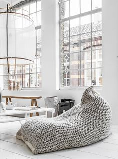 How do you turn grey and white into the coziest of colors? Add a gigantic sweater bean bag chair into the mix.