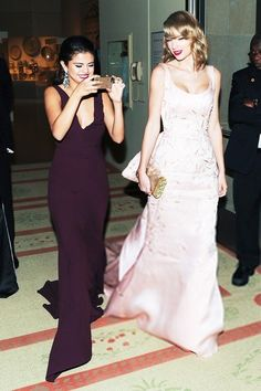 Selena looks like she's taking the pucture of an ugly person and Taylor's…