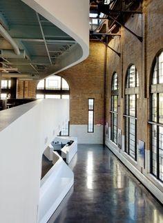 brick exterior walls, concrete floors, white interior walls, dark trusses