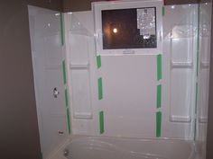 Tub surround 5 pieces installed. Taped to hold it there