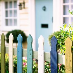Use a fence to create a front garden with a difference. This design has been painted in colourful shades that make passers-by feel that bit happier. We all dream of a white picket fence, but if you're lucky enough to have one, why not take the plunge and go for something a little more daring? Paint your fence in pastel hues for a pretty, rather than garish, look.