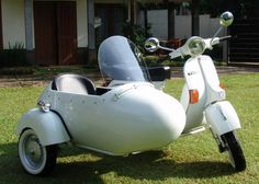 White Vespa with Sidecar.