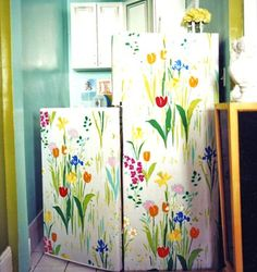 Generic white refrigerator? No problem: swath it in  spring-floral wallpaper.
