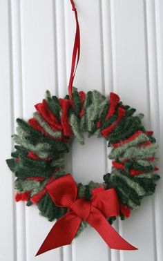 Christmas Wreath from old sweaters!  Cute idea -- but I would not sacrifice old sweaters-- I'd just use felt if old sweaters were no where in sight and not in the budget!  CUTE wreath!