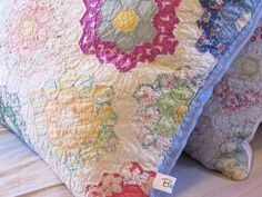 Rescued old quilts sewn into comfy down cushions.
