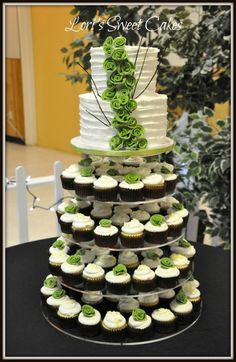 Wedding Cupcake Tower by LorisSweetCakes. I love the that shade of green on the white.