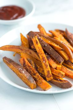 Baked sweet potato fries that are caramelized and crispy on the outside and tender on the inside. No fryer needed here. Consider making a double batch, this one's addictive. From inspiredtaste.net | @inspiredtaste